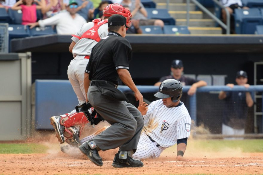 Dom Thompson-Williams scores sliding into homeplate on a single by Angel Aguilar. (Robert M. Pimpsner)