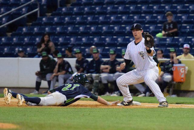 A pickoff attempt at first base, Yankees first baseman Drew Bridges (Robert M. Pimpsner)