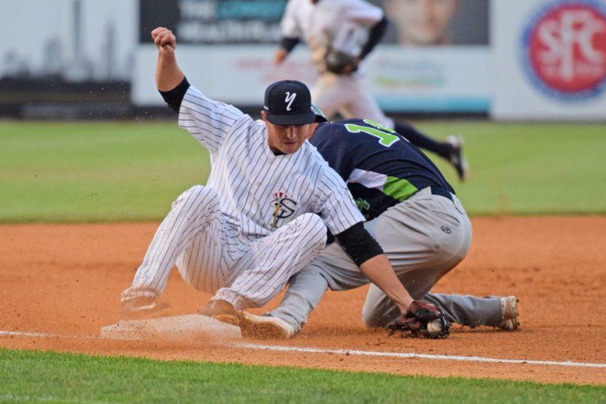 Steven Pallares steals third base on a close play, colliding with Mandy Alvarez. (Robert M. Pimpsner)
