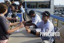 Isaias Tejeda and Luis Torrens sign autographs before the game.