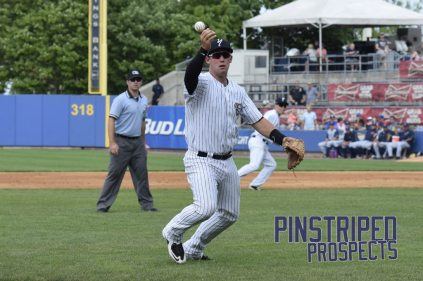 Drew Bridges makes the play on a ball that almost got away from him (Robert M. Pimpsner)
