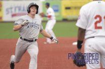 Jeff Hendrix Slides into third base (Robert M. Pimpsner)