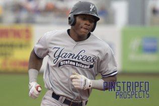 Jhalan Jackson rounds the bases on his 2-run homerun (Robert M. Pimpsner)