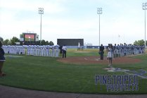 The Staten Island Yankees and Brooklyn Cyclones lineup for the national anthem on Opening Day (Robert M. Pimpsner)