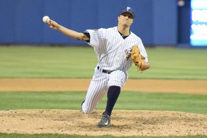 Bret Marks fires a pitch to the plate (Robert M Pimpsner)