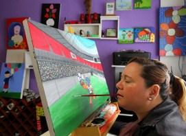 Artista tetraplégica pinta quadro em homenagem ao novo Mané Garrincha