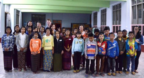 Sam Shugart ('15), Nway Khine ('15), Katie Schirmer ('17) and Ira Yeap ('14) with a group of their students in Myanmar.