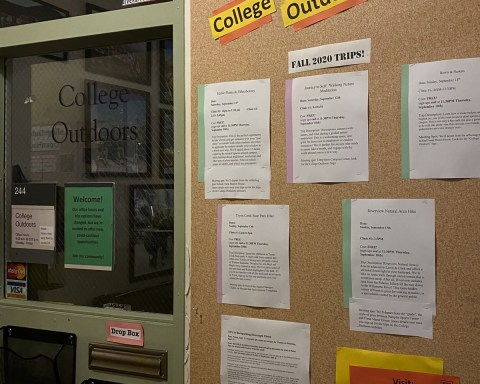 Photo of the bulletin board outside the College Outdoor office