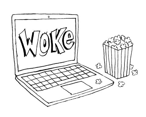 "Computer sits on table with ""Woke"" on the screen and a bag of popcorn to the right"
