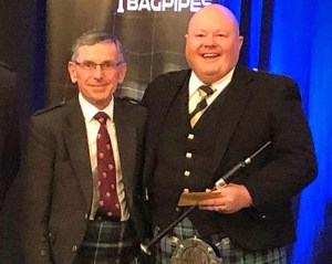 Prestigious silver chanter awarded to Pipe Bands Queensland president Andrew Roach.