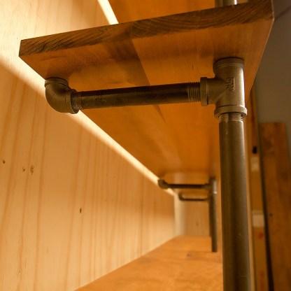 Industrial plumbing pipe four level floor shelf support