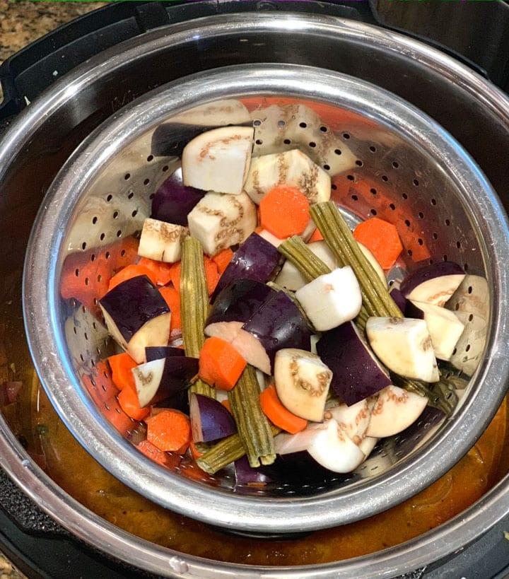 pot-input veggies being cooked in instant pot