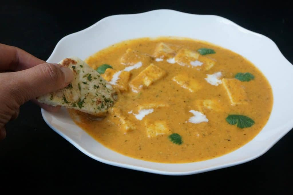 Chunks of paneer or cottage cheese cooked in a mildly spiced tomato gravy. Delicious and very easy to make Paneer Butter Masala in the instant pot. Great to dip naan.