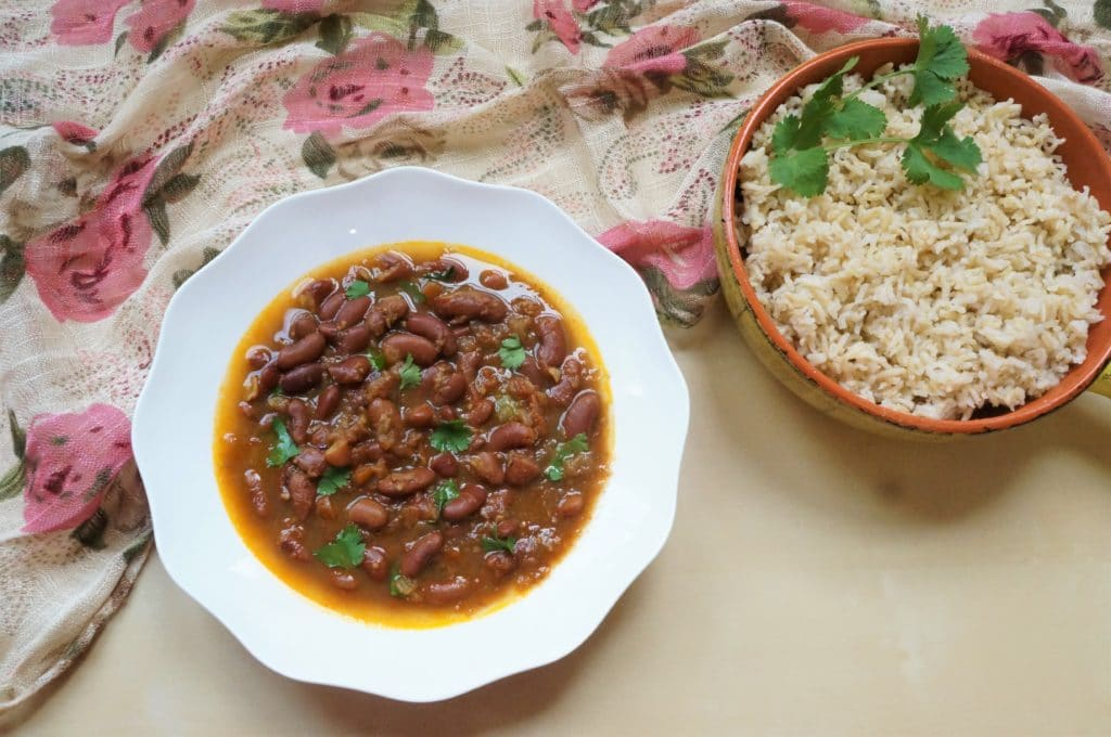 Rajma Masala / Red Beans Curry made in Instant Pot in a white bowl with brown rice