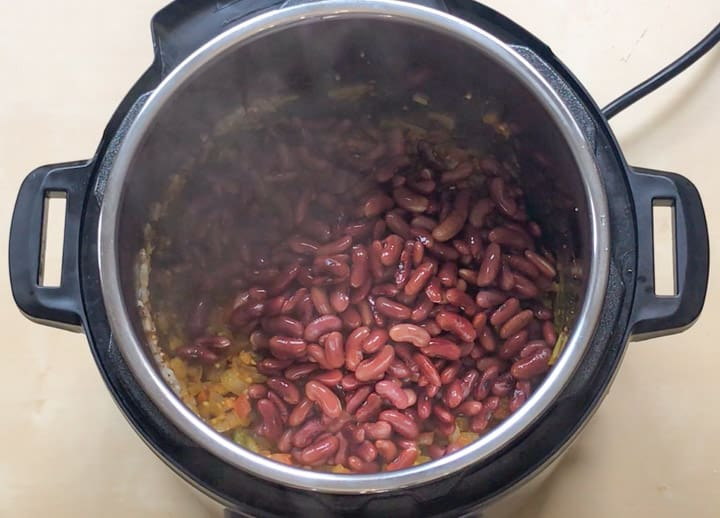 Add soaked red beans to make Rajma Masala