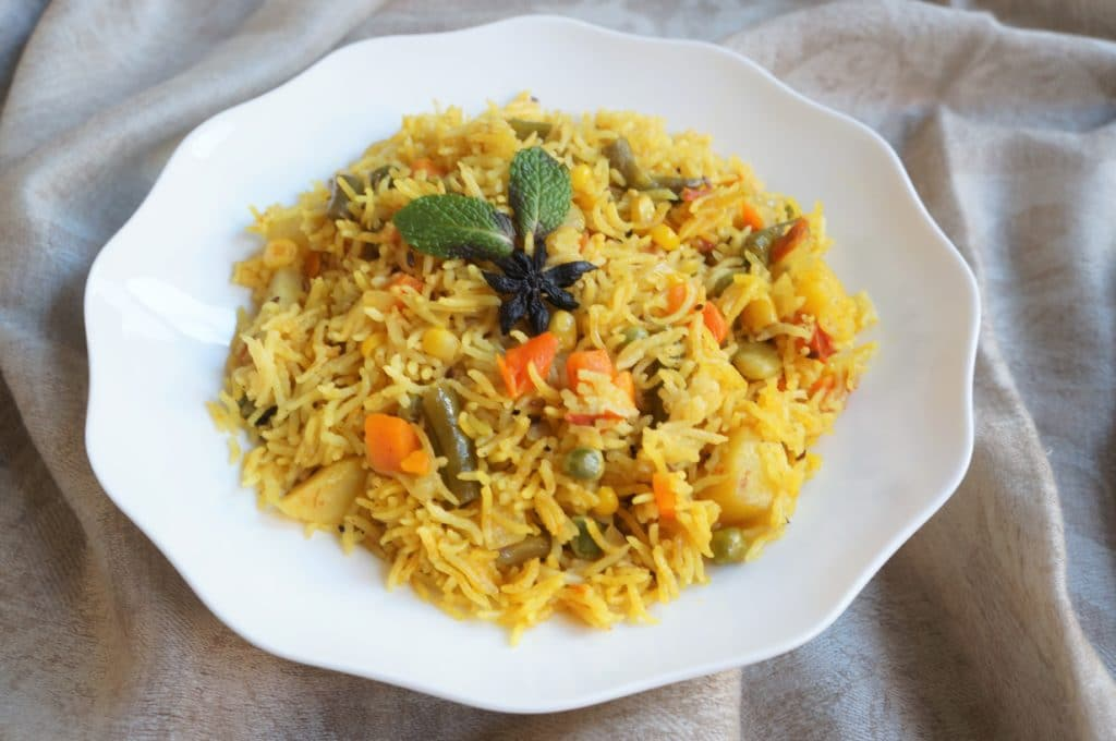 Vegetable Pulao in a white bowl made in Instant Pot Pressure Cooker