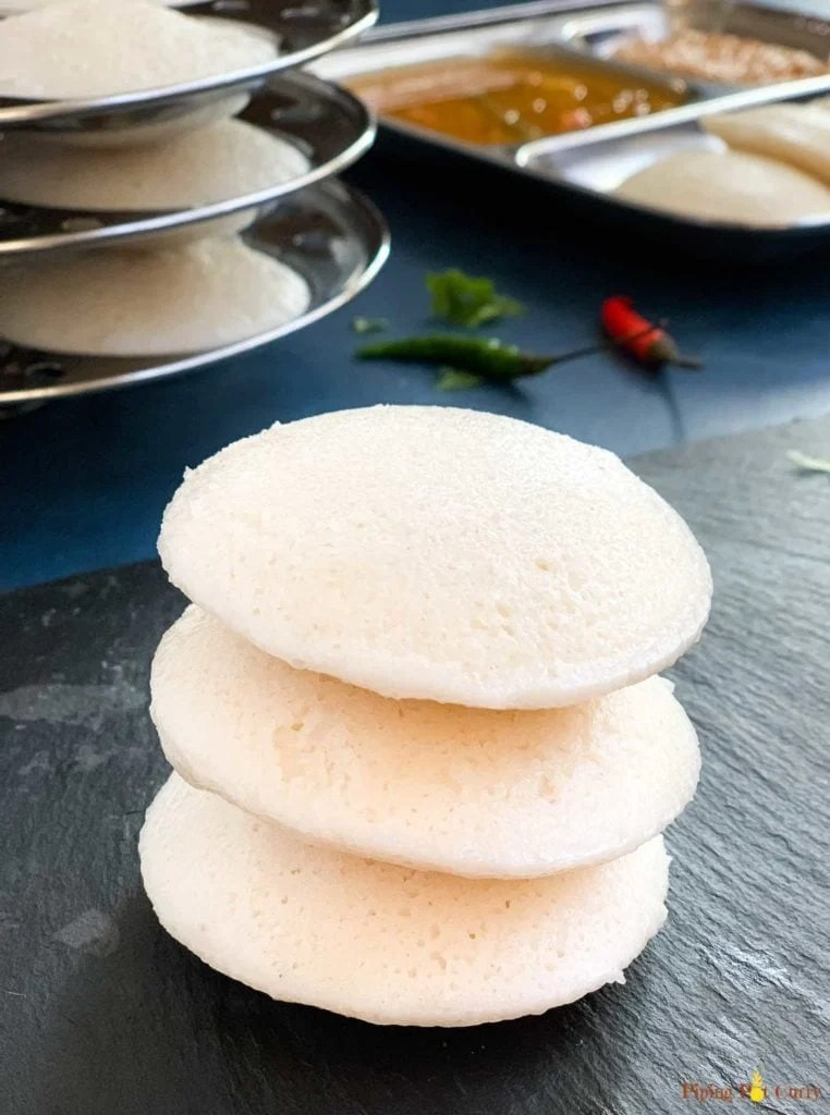 A stack of 3 fluffy spongy idli's