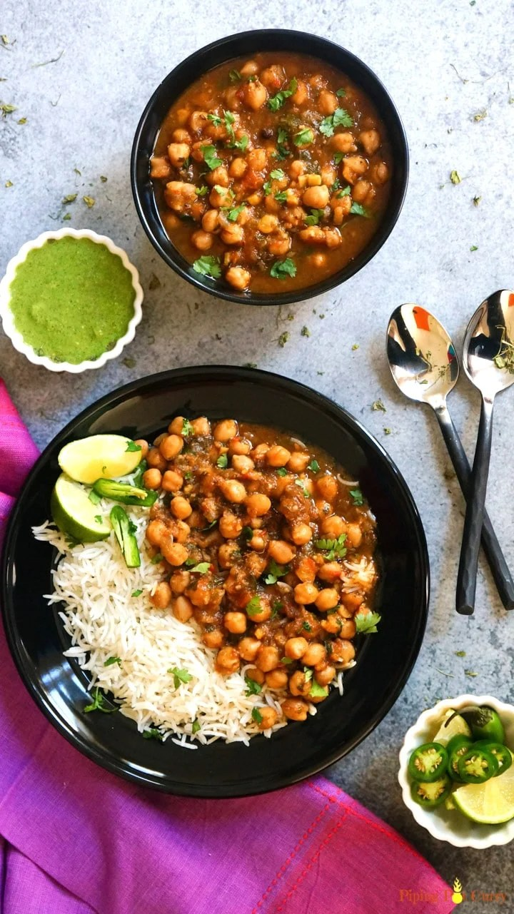 Instant Pot Chana Masala or Chole served with rice, lemon and green chutney