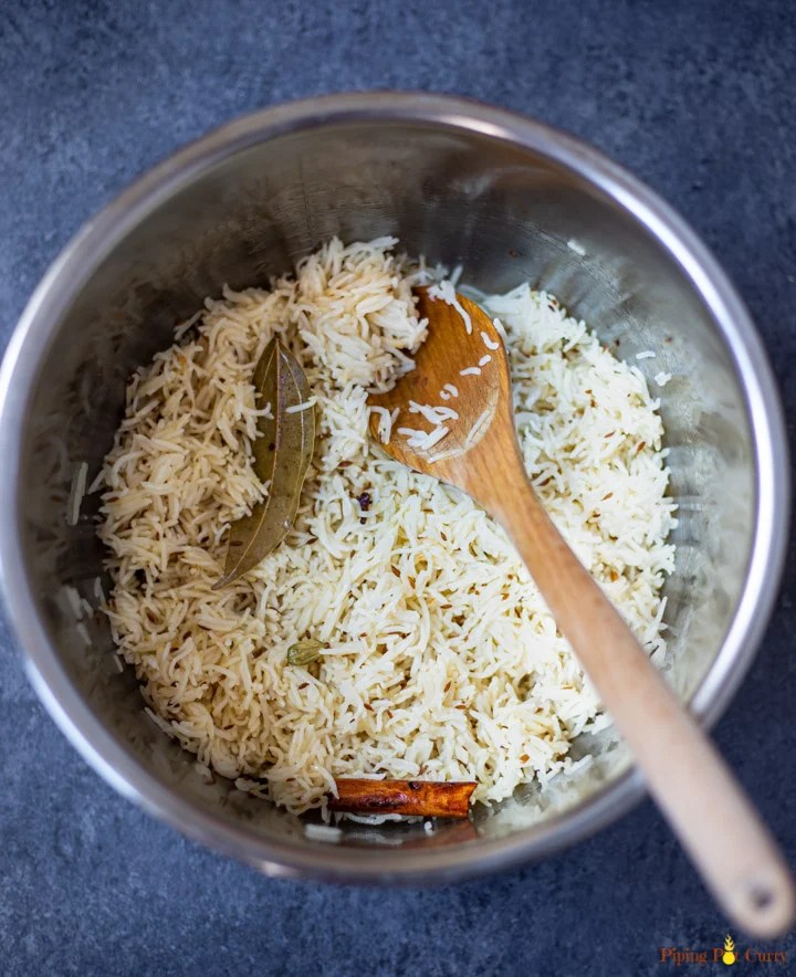 Cooked Basmati Rice flavored with cumin, cinnamon and bay leaf in instant pot pressure cooker