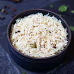 cumin rice in a black bowl