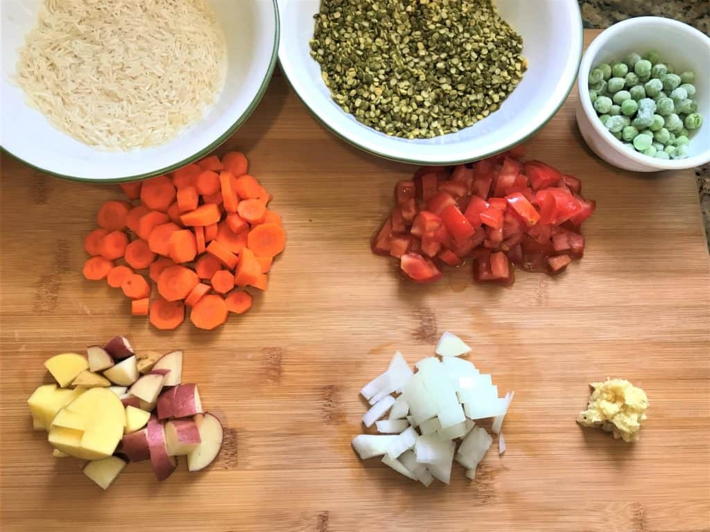 Pressure Cooker Masala Khichdi Ingredients - Rice, Split Green Lentils, Green Peas, Carrots, Potatoes, Onions, Tomatoes, Ginger