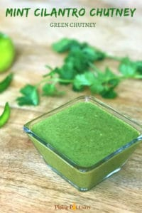 A cool, spicy and tangy green chutney. This is a no-cook mint cilantro dip, blended with ginger, onion and seasoning. Perfect with appetizers. | #chutney #greenchutney #mint #cilantro #cilantrodip #pipingpotcurry | pipingpotcurry.com