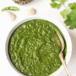 Indian green mint cilantro chutney in a white bowl