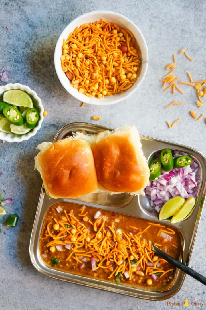 Misal Pav made in Instant Pot along with onions, lemons and farsan on the side