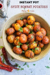 Spicy Bombay Potatoes or Masala Aloo, is baby potatoes cooked with aromatic spices. Perfect to serve as appetizer or a side dish, these delicious Bombay Potatoes take just 20 minutes to make in the Instant Pot | #babypotatoes #instantpot #potatoes #pressurecooker #bombaypotatoes #spicypotatoes | pipingpotcurry.com