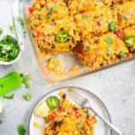 Healthy Vegetarian Mexican Rice & Bean Casserole is easy to make and filled with cheesy goodness, along with brown rice and lots of veggies. This is an easy gluten free & vegetarian casserole for a weeknight dinner or your next party! AD #vegetarian #Mexican #casserole #glutenfree | pipingpotcurry.com