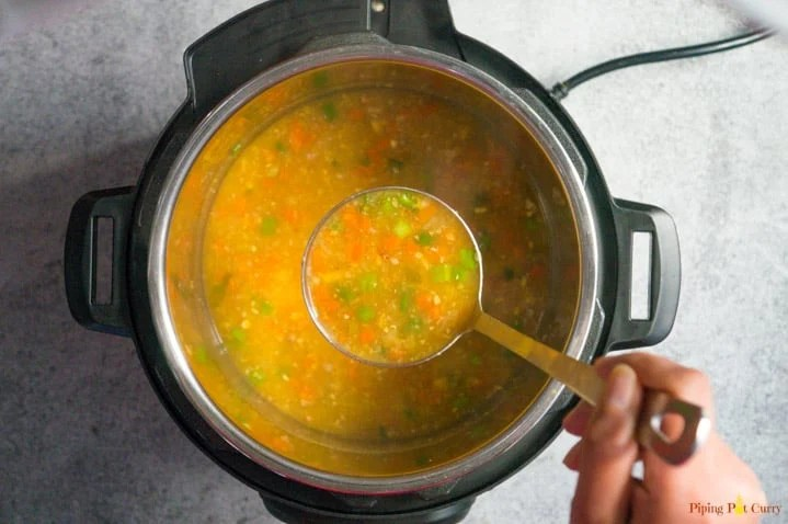 A ladle full of Sweet Corn Soup made in the Instant Pot