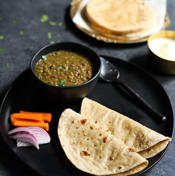 Phulka Roti - Chapati - Whole Wheat Indian Flatbread in a plate with dal