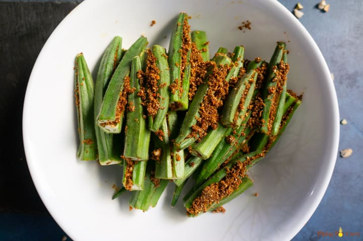 Okra stuffed with spices in a white bowl