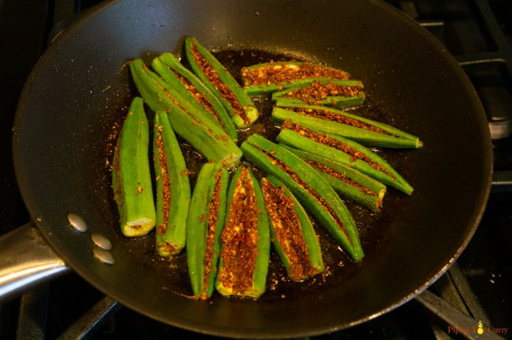 Stuffed Bhindi (okra) cooking in a frying pan