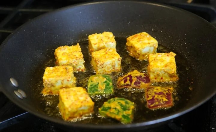 Fry marinated paneer in a pan
