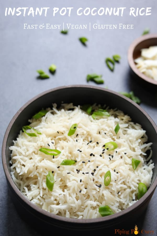 Coconut Rice made in the pressure cooker served in a black bowl topped with sesame seeds and scallions