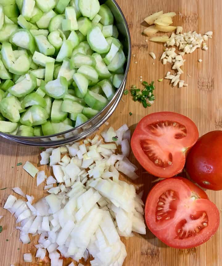 Ingredients to make ridge gourd curry or Turai ki subzi