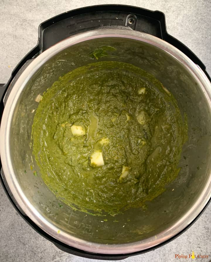 Potatoes in pureed spinach curry in the instant pot