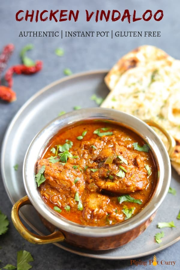 Authentic Chicken Vindaloo served in a bowl along with naan bread