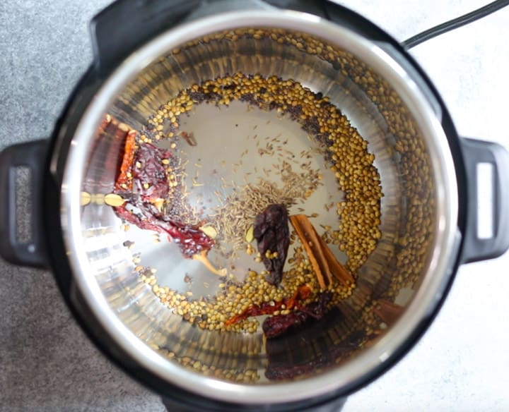Roasting whole spices in the instant pot to make chicken vindaloo