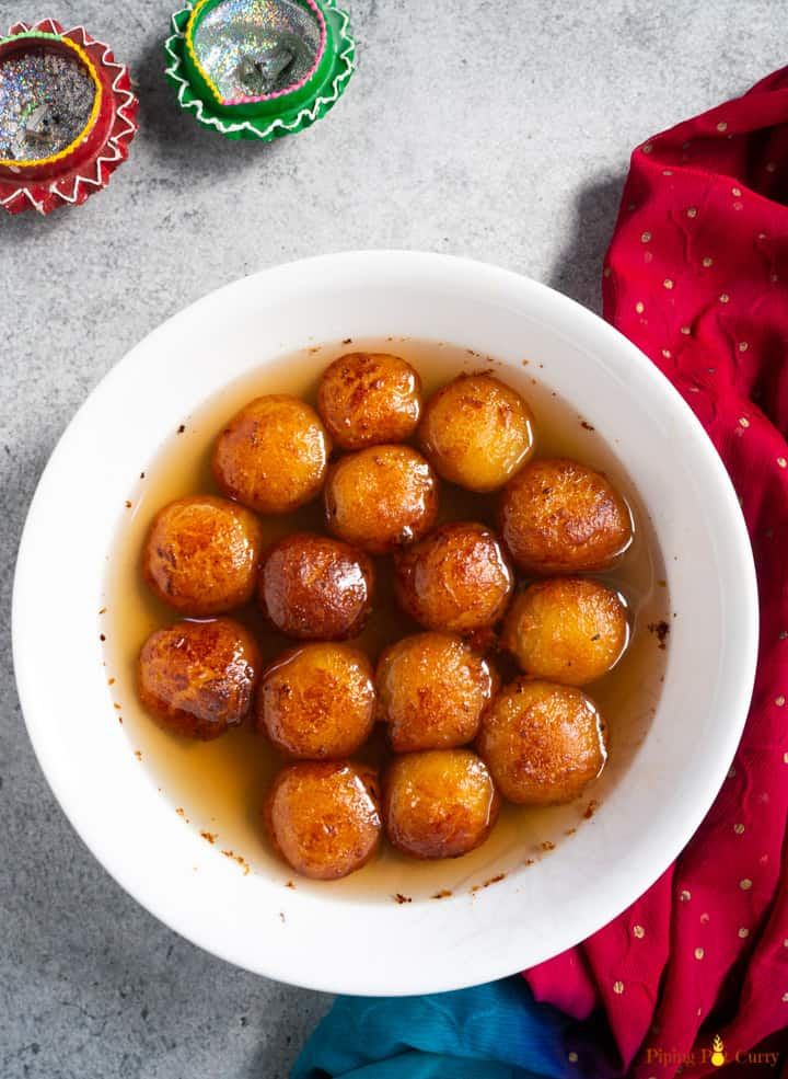 Khoya Gluab Jamun fried and dipped in sweet syrup