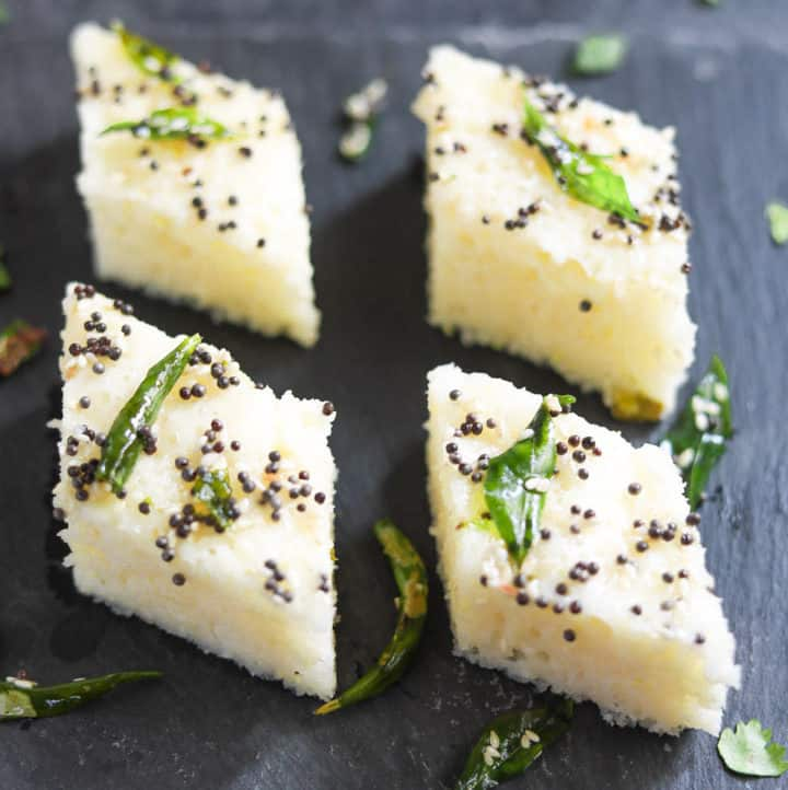 Rava Dhokla (Savory Semolina Cakes) made in the instant pot, served with tempering on a snack plate
