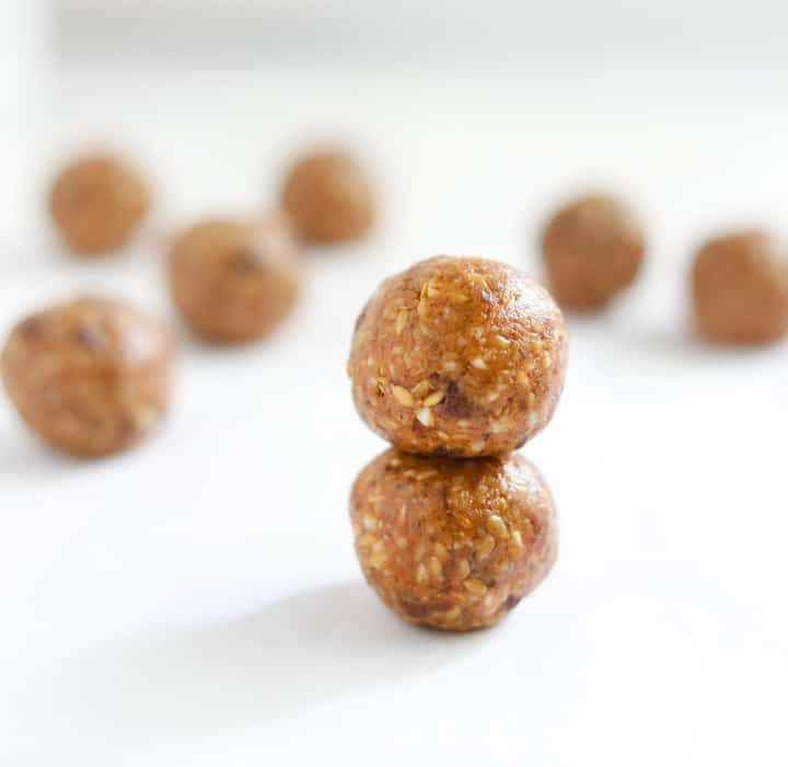 Almond Butter Date Energy Bites - rolled into balls and laid out on a white board