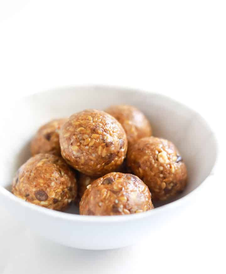 Almond Date Chocolate Chip Energy Balls in a white bowl