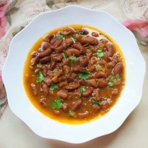 Rajma (Red Beans Curry) garnished with cilantro served in a white bowl