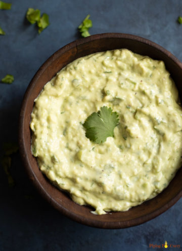 Creamy Dip in a wooden bowl garnished with cilantro