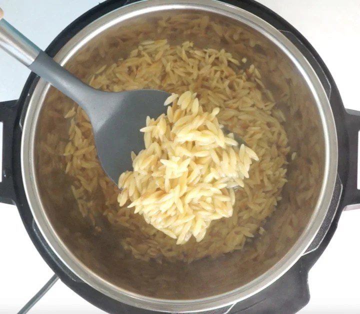Orzo cooked in instant pot in a ladle
