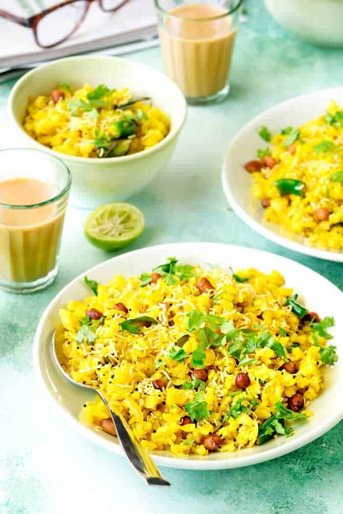 Kanda Poha in a plate along with chai