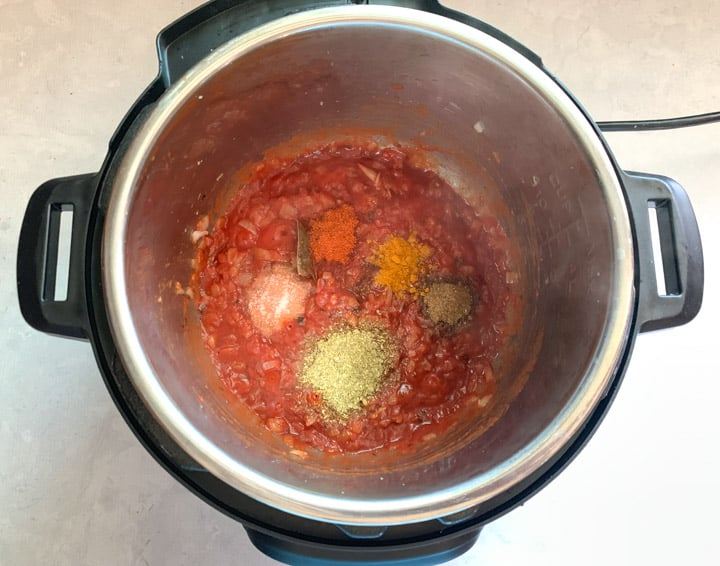 Tomato and spices cooking in an instant pot