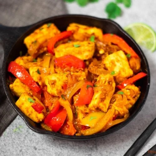 Paneer Jalfrezi curry with peppers in a pan